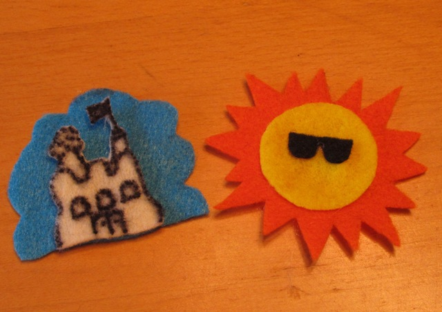 homemade-hair-clips-closeup-of-sandcastle-and-sun-with-sunglasses